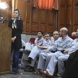 French lecturer Clotilde Reiss, left, who was reportedly arrested at Tehran airport on July 1, and jailed on charges of spying linked to riots over last month's presidential election, stands in the court room in Tehran, Iran, Saturday.