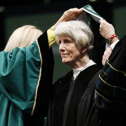 Pamela Atkinson receives an honorary degree during Utah Valley University commencement in Orem on Thursday, April 30, 2015.