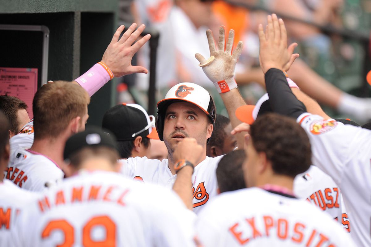 Nick Johnson #36 of the Baltimore Orioles celebrates hittiing a solo home run in the eighth inning during a baseball game against the Tampa Bay Rays at Oriole Park at Camden Yards on May 13, 2012 in Baltimore, Maryland.