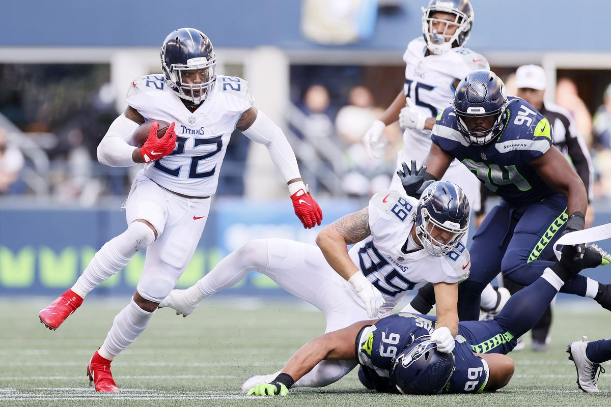 Derrick Henry #22 of the Tennessee Titans carries the ball during the third quarter against the Seattle Seahawks at Lumen Field on September 19, 2021 in Seattle, Washington.