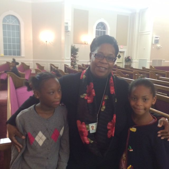 Nicole Gates and her daughters Brooklyn and Bheanna who attend St. John's Catholic School.