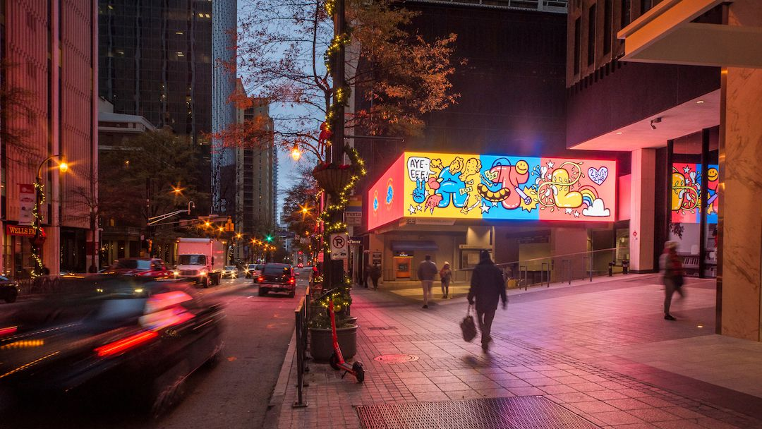 Lighted sign with colorful artwork of ATL on it.