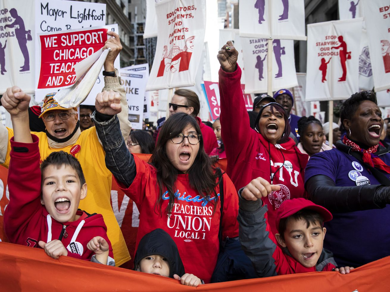 Members of the Chicago Teachers Union and SEIU Local 73 march through the Loop on Oct. 14.