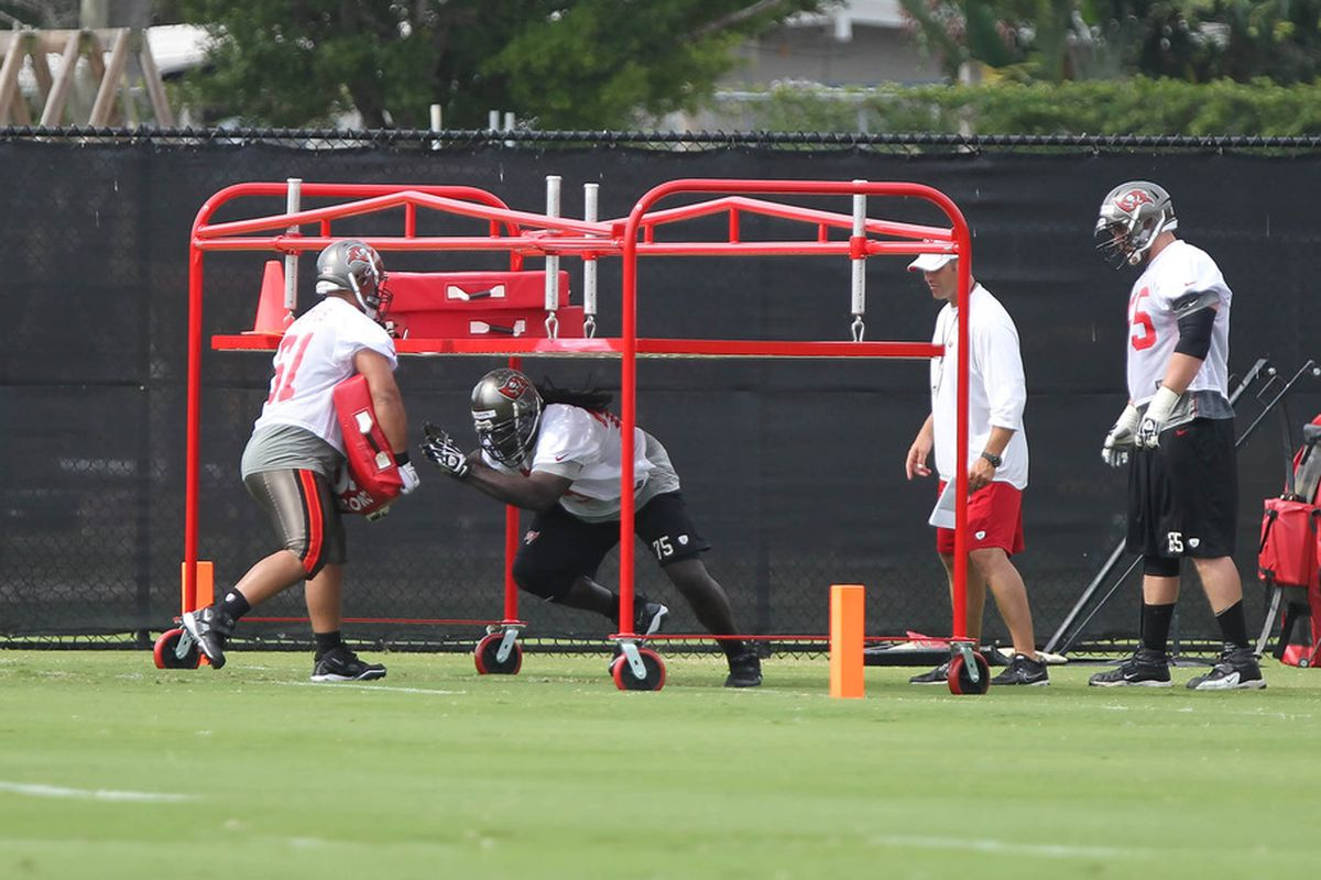 May 15, 2012; Tampa, FL, USA; Tampa Bay Buccaneers guard Davin Joseph (75) and center Moe Petrus (61) workout during organized team activities at One Buc.   Mandatory Credit: Kim Klement-US PRESSWIRE