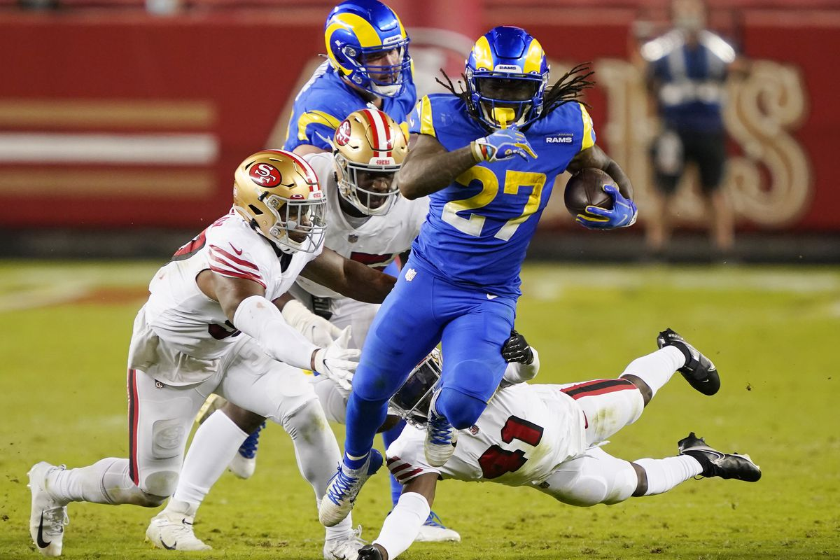Darrell Henderson Jr. #27 of the Los Angeles Rams carries the ball against the San Francisco 49ers during the third quarter of their NFL football game at Levi's Stadium on October 18, 2020 in Santa Clara, California.