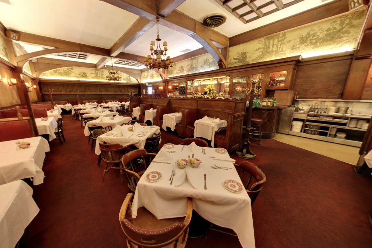 The deep walls and white tablecloths of a historic Hollywood restaurant.