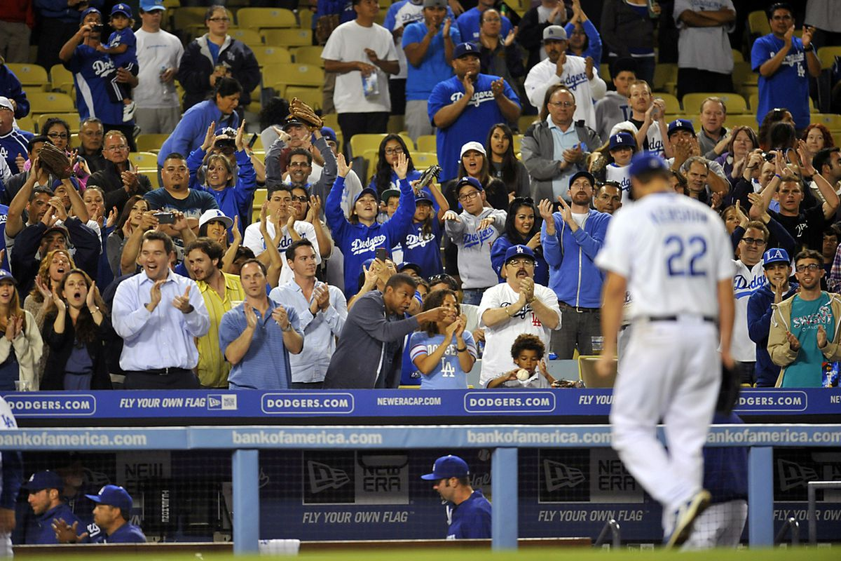 May 14, 2013; Los Angeles, CA, USA; Los Angeles Dodgers fans cheer starting pitcher Clayton Kershaw (22) as he is relieved in the ninth inning against the Washington Nationals at Dodger Stadium. Mandatory Credit: Gary A. Vasquez-USA TODAY Sports