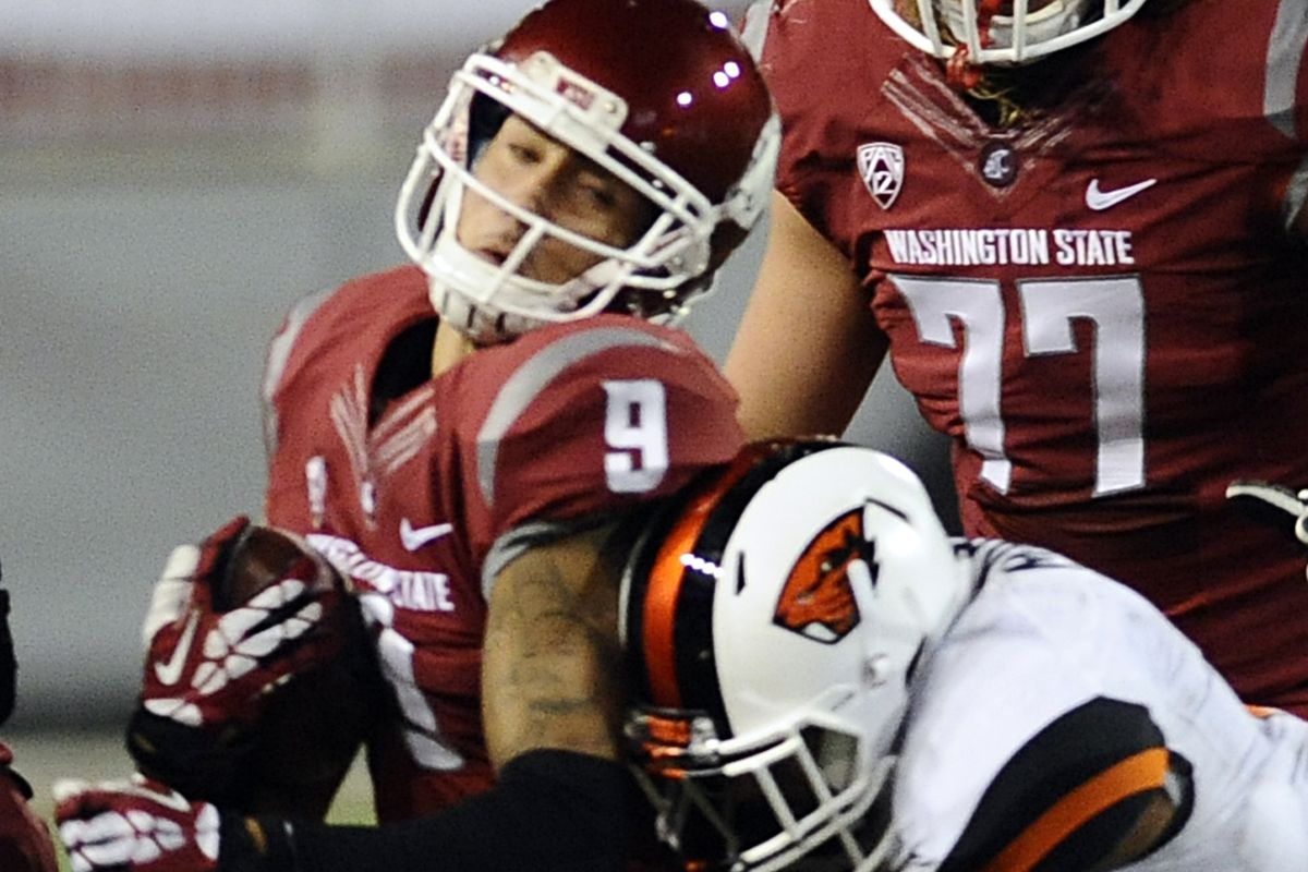 Oregon St.'s Sean Martin takes down Washington St.'s Gabe Marks. Marks was 1 of 10 Cougars with a catch, but for only 2/3 as much yardage as the Beaver receivers had.