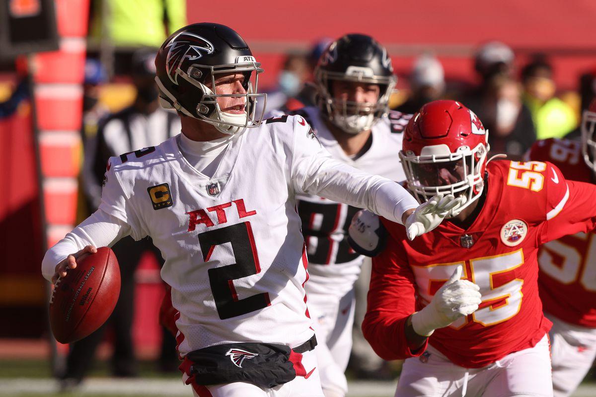 Matt Ryan #2 of the Atlanta Falcons looks to pass in the first quarter against Frank Clark #55 of the Kansas City Chiefs at Arrowhead Stadium on December 27, 2020 in Kansas City, Missouri.