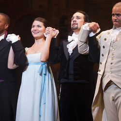 """In this Thursday, Aug. 6, 2015, file photo, Leslie Odom Jr., left, Phillipa Soo, Lin-Manuel Miranda and Christopher Jackson appear at the curtain call following the opening night performance of """"Hamilton"""" at the Richard Rodgers Theatre in New York. The production is still on Broadway, but much of the original cast members have left the show."""