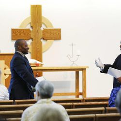 Rev. Jerrod Lowry, right, introduces Pastor Ron Williams at the Community of Grace Presbyterian Church in Sandy Sunday, Aug. 17, 2014. Williams, a nondenominational Christian pastor, has written books about fitness, food and faith.