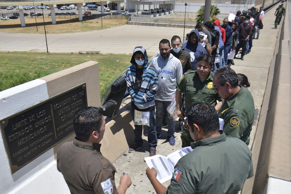 United States Border Patrol officers in Nuevo Laredo, Mexico, return a group of migrants to the Mexico side of the border earlier this month.