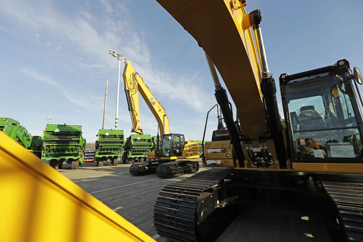 construction equipment made by Caterpillar are readied for export to Asia at the Port of Tacoma in Tacoma, Wash.