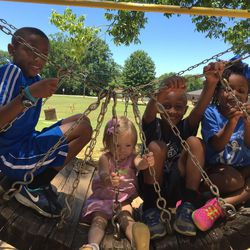 The Oden siblings hang out on the playground: Elijah, Annabelle, Gabbi and Kentrell.