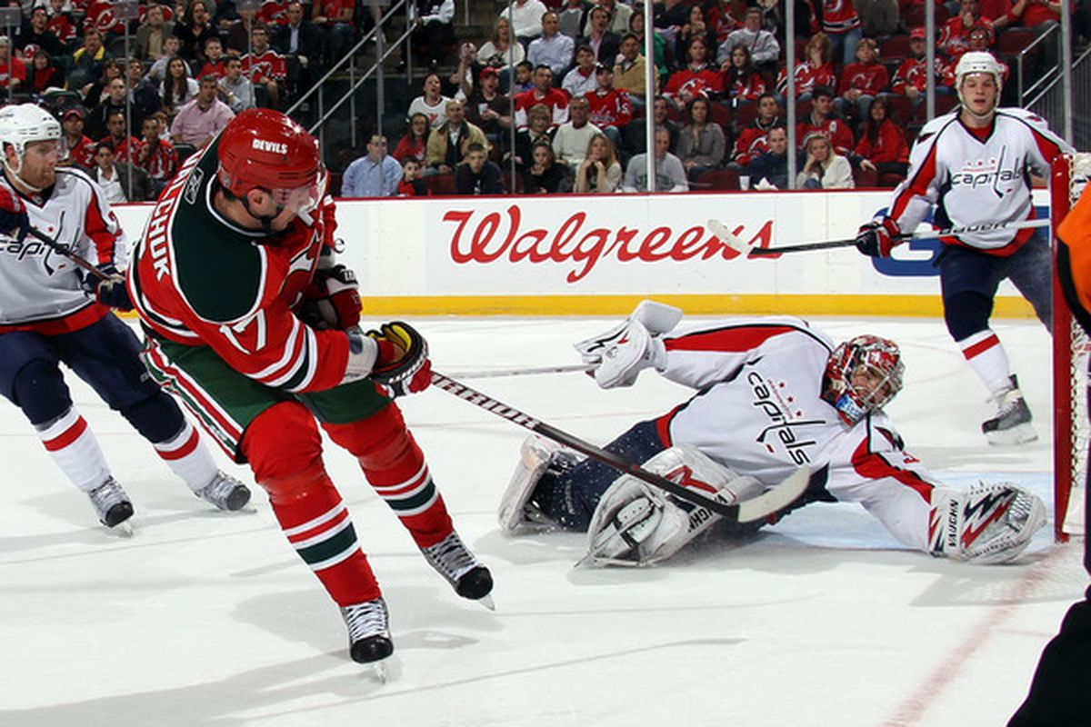 NEWARK, NJ - MARCH 18: Michal Neuvirth #30 of the Washington Capitals makes the glove save on Ilya Kovalchuk #17 of the New Jersey Devils at the Prudential Center on March 18, 2011 in Newark, New Jersey.  (Photo by Bruce Bennett/Getty Images)