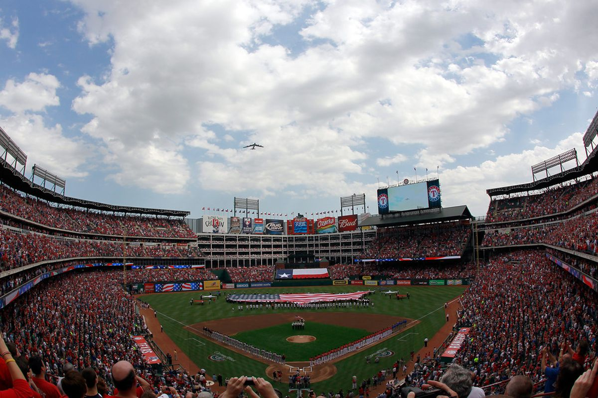 ARLINGTON, TX - APRIL 01:  A B-52 Bomber flies over the Rangers Ballpark in Arlington during the National Anthem during Opening Day on April 1, 2011 in Arlington, Texas.  (Photo by Tom Pennington/Getty Images)