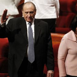 President Thomas S. Monson, with his daughter Ann Dibb, waves after the afternoon session of the 182nd Annual General Conference for The Church of Jesus Christ of Latter-day Saints at the LDS Conference Center in Salt Lake City on Saturday, March 31, 2012.