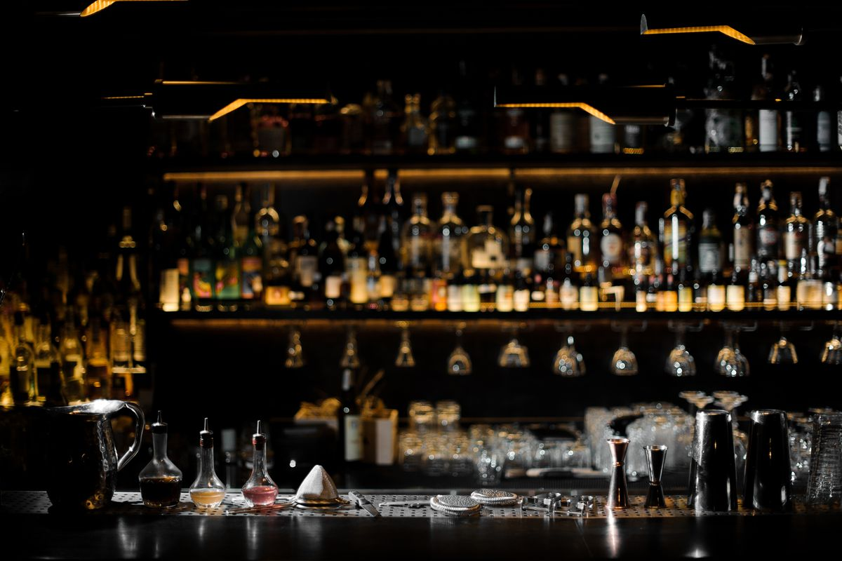 dark bar with alcohol on shleves