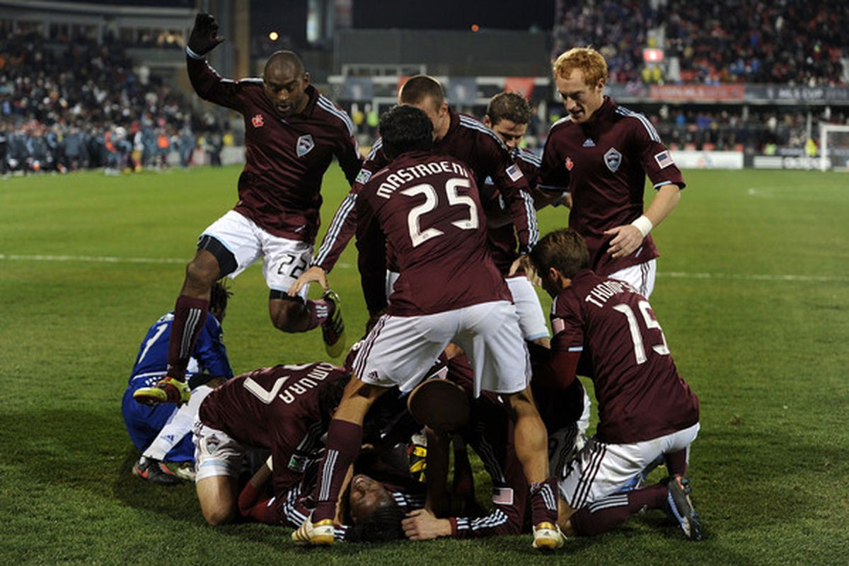 TORONTO ON - NOVEMBER 21:  Macoumba Kandji #10 of the Colorado Rapids celebrates his goal with teammates during overtime against FC Dallas the 2010 MLS Cup match at BMO Field on November 21 2010 in Toronto Canada.  (Photo by Harry How/Getty Images)