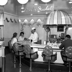 Pat Magura and Ella Caldwell stop at the Bowl 'n Basket at Hotel Utah for a light snack. Behind the counter of the newly installed facility is Lee Bell. The new soup and snack bar is part of a $500,000 modernization project just completed at the hotel. Nov. 24, 1961.