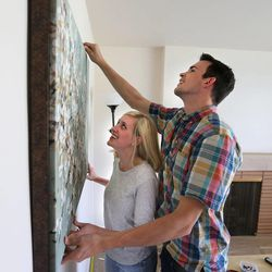 Newlyweds Jason, 27, and Emily Brand, 26, hang art in their new home July 20, 2015, in Holladay. A new study from University of Utah professor Nicholas Wolfinger shows that those who tie the knot after their early 30s are now more likely to divorce than those who marry in their late 20s.