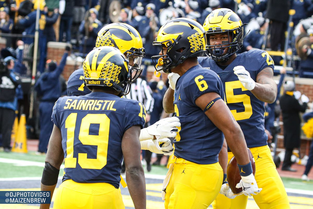 Michigan moves up in both major polls after trucking Michigan State