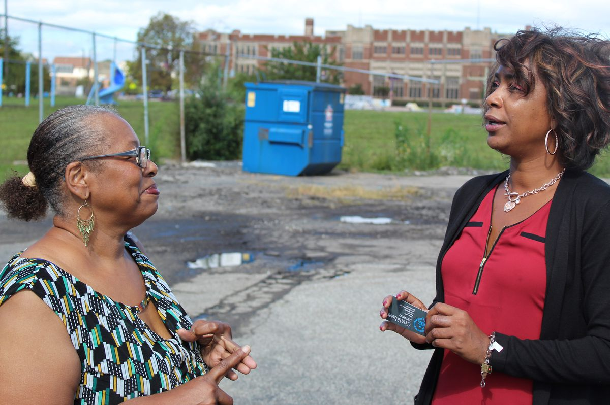 Monica Davie, right, and Diane Pompey, trying to count the number of principals the school has had since it opened in 2014. They settled on roughly one per year.