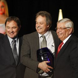 Jimmer Fredette's father, Al Fredette receives an award for best sports play on behalf of his son from Gov. Gary Herbert, left, and NBA Commissioner David Stern on Thursday.