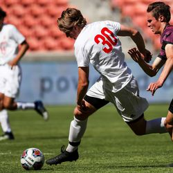 Judge Memorial's Matt Skorut and Morgan's Dallon Gunn move for the ball in the 3A boys soccer championship at Rio Tinto Stadium in Sandy on Tuesday, May 18, 2021.