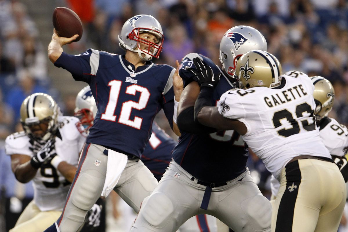 Aug 9, 2012; Foxborough, MA, USA; New England Patriots quarterback Tom Brady (12) throws a pass against the New Orleans Saints during the first quarter of the preseason game at Gillette Stadium. Mandatory Credit: David Butler II-US PRESSWIRE