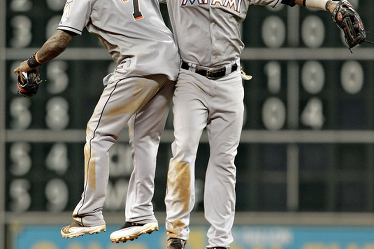 HOUSTON,TX-MAY 09 : Jose Reyes #7 of the Miami Marlins and Emilio Bonafacio #1 celebrate their 5-3 win over the Houston Astros in 12 innings on May 9, 2012 at Minute Maid Park in Houston, Texas. (Photo by Bob Levey/Getty Images)