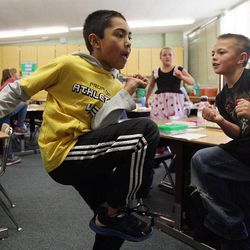 Daniel Berroteran, center, and Jeff Pearce exercise in Nicole Carter's class at Tolman Elementary School in Bountiful, Monday, Nov. 26, 2012.