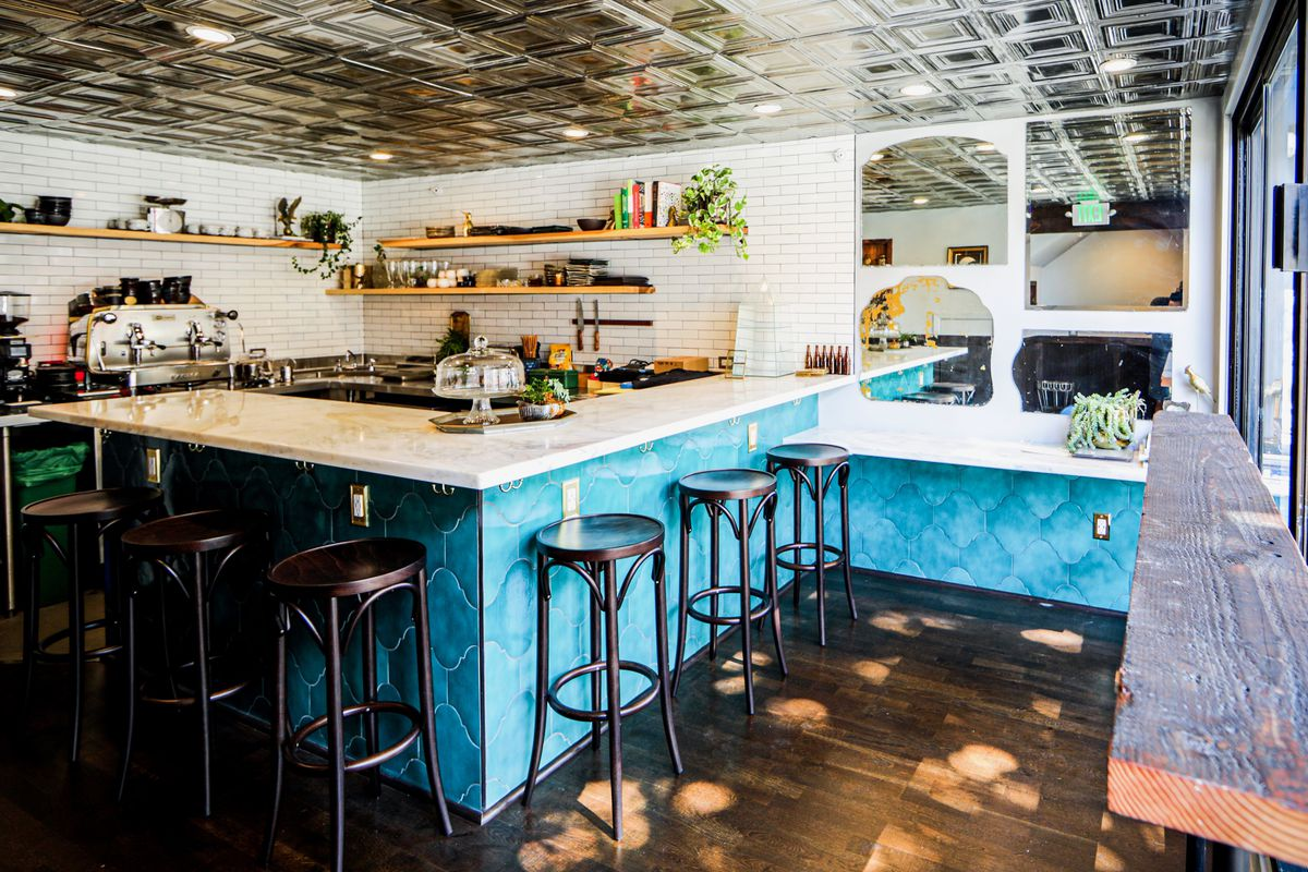 A blue-tiled bar counter at the North Beach cafe Family
