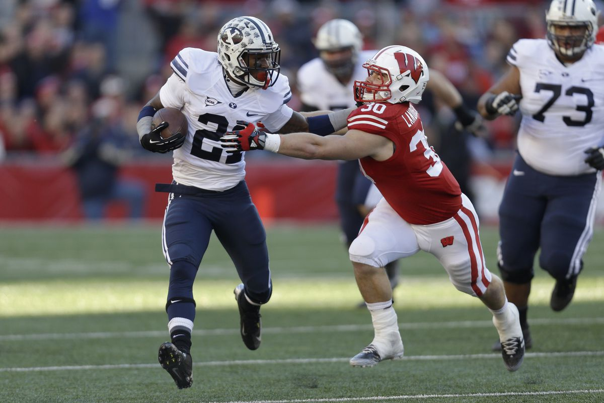 Jamaal Williams rushes against Wisconsin