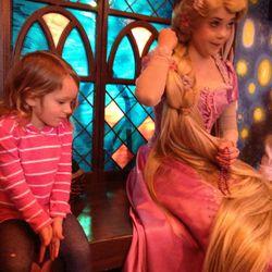 Kyla meeting her favorite Disney character.