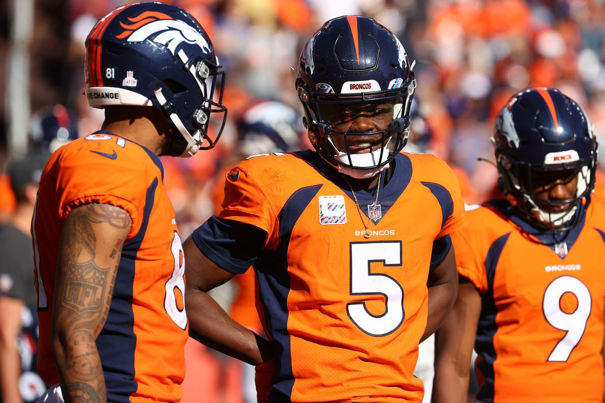 Teddy Bridgewater #5 of the Denver Broncos talks to a teammate against the Baltimore Ravens at Empower Field At Mile High on October 3, 2021 in Denver, Colorado.