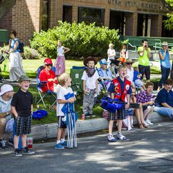 Families scream at the request of a clown in the Days of '47 Union Pacific Railroad Youth Parade held Saturday, July 18, 2015, in Salt Lake City.