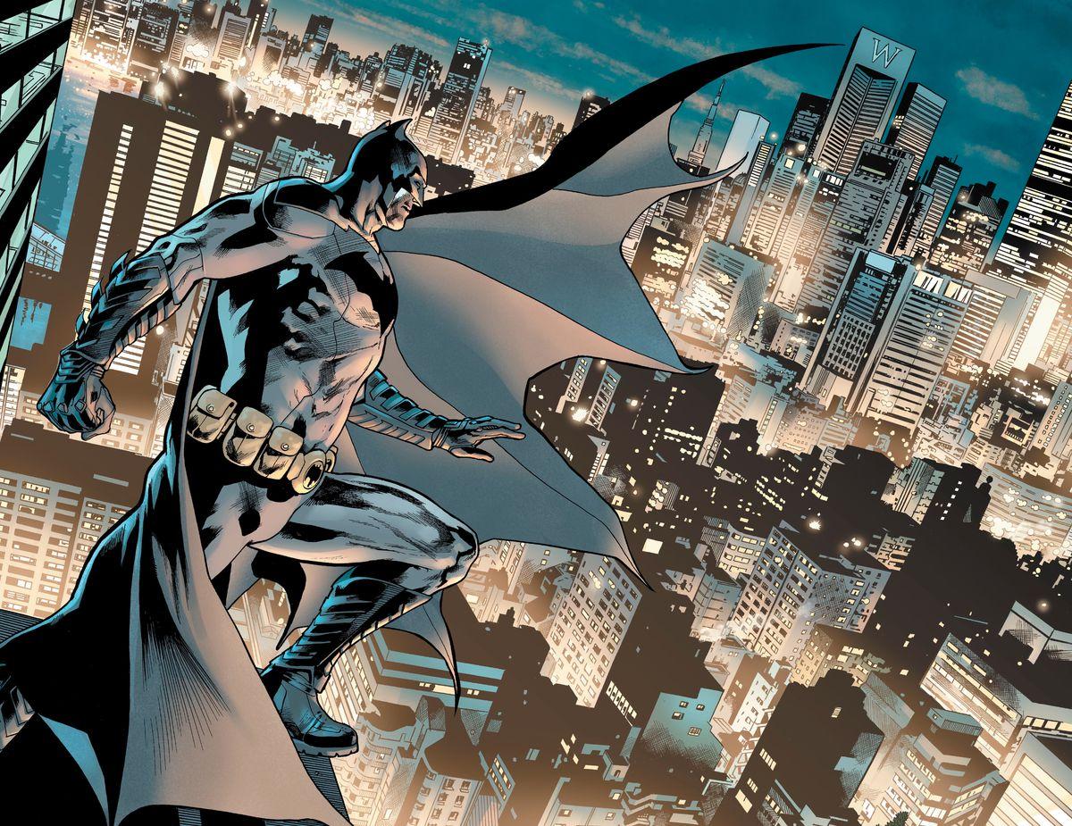 Batman stands on a rooftop above Gotham's streets, cap billowing, in The Batman's Grave #1, DC Comics (2019).