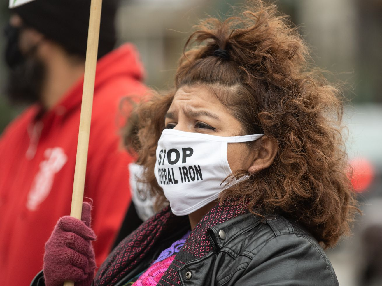 Nelly Martinez attends a November 2020 protest to demand Chicago Mayor Lori Lightfoot to deny the final permit that will allow General Iron to move from Lincoln Park, a mostly white neighborhood, to the Southeast Side, which has a mostly Latino population.   Pat Nabong/Sun-Times