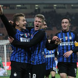 Facundo Colidio (L) of FC Internazionale celebrates his second goal with his team-mates during the Primavera SuperCup match between FC Internazionale U19 and AS Roma U19 at Stadio Giuseppe Meazza on January 7, 2018 in Milan, Italy.