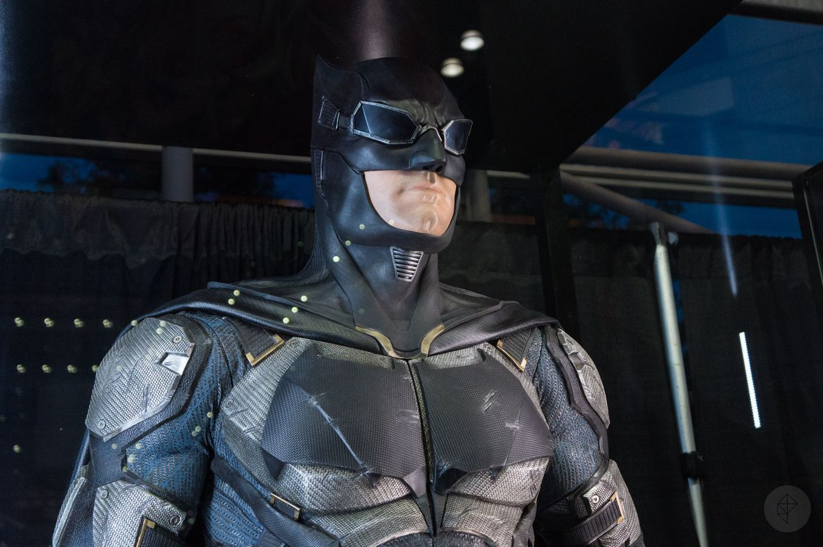 Batman costume from Justice League movie in glass case at NYCC 2017, close-up