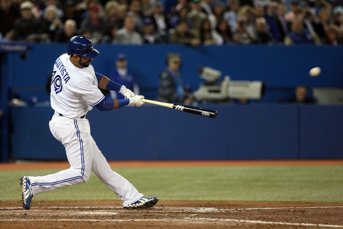 Toronto Blue Jays right fielder Jose Bautista (19) hits a solo home run in the 5th inning against the New York Yankees at the Rogers Centre.