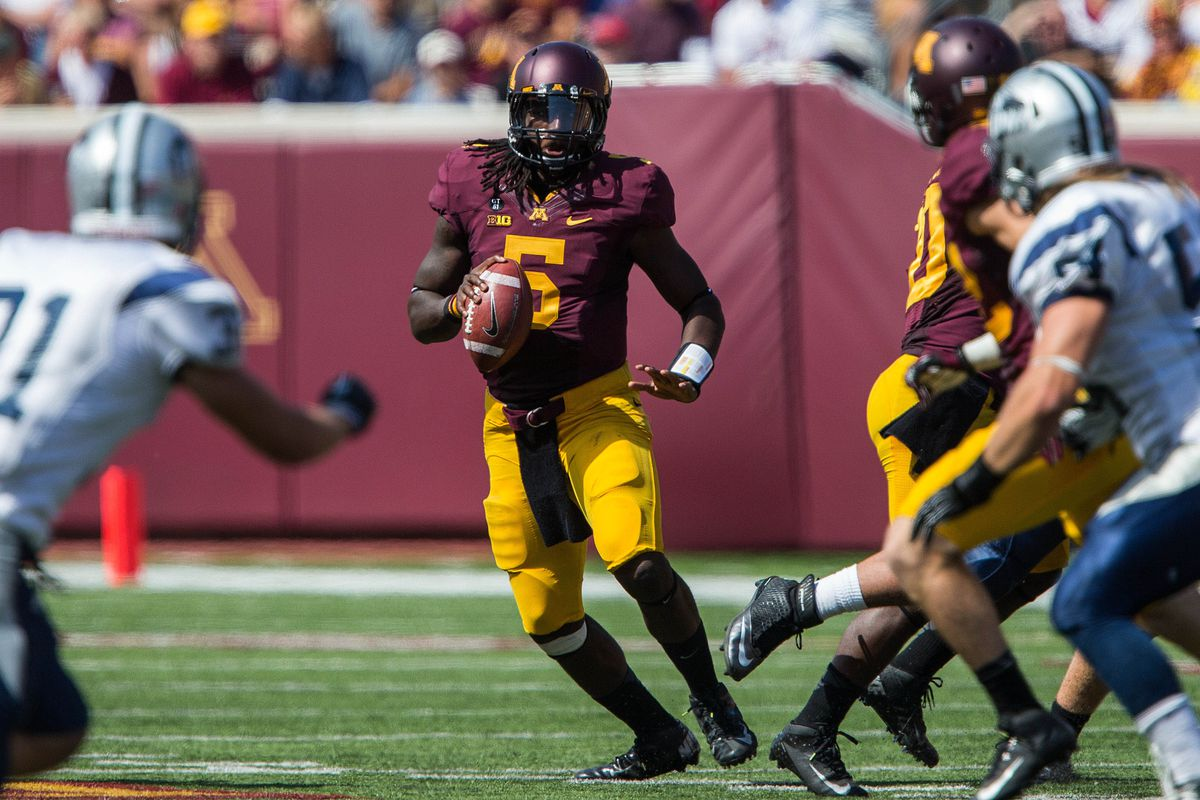 Sept 8, 2012; Minneapolis, MN, USA: Minnesota Gophers quarterback MarQueis Gray (5) looks to pass in the second half against the New Hampshire Wildcats at TCF Bank Stadium. The Gophers won 44-7. Mandatory Credit: Jesse Johnson-US PRESSWIRE
