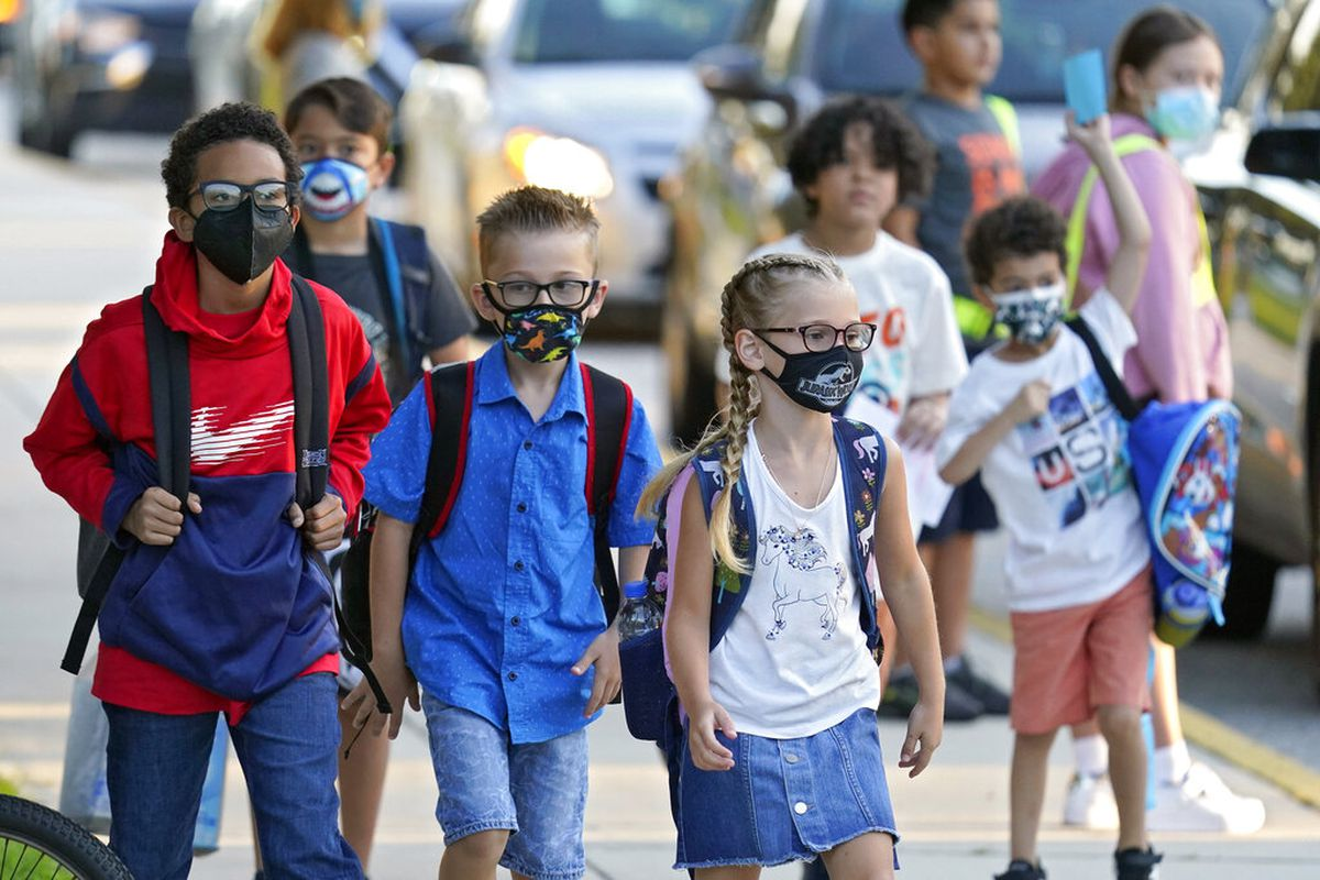 Students arrive for the first day of school in Florida.