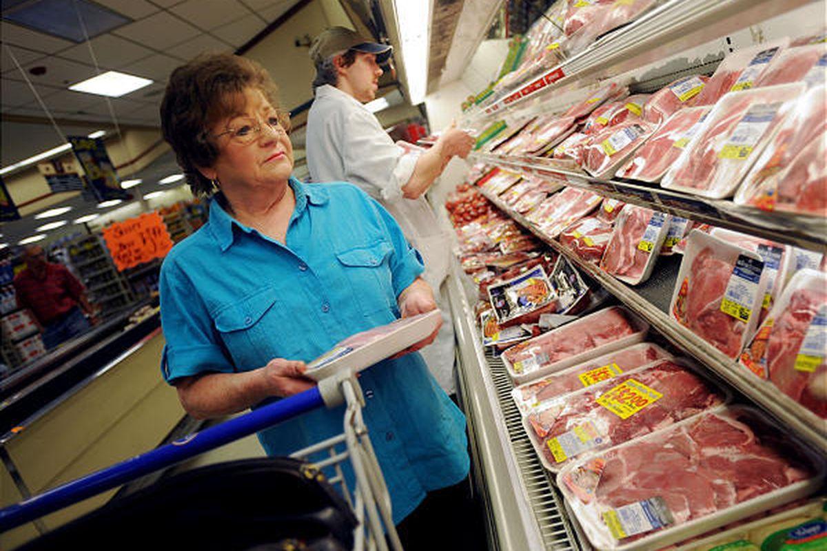 Sondra Meadows shops for pork chops in Charleston, W.Va.