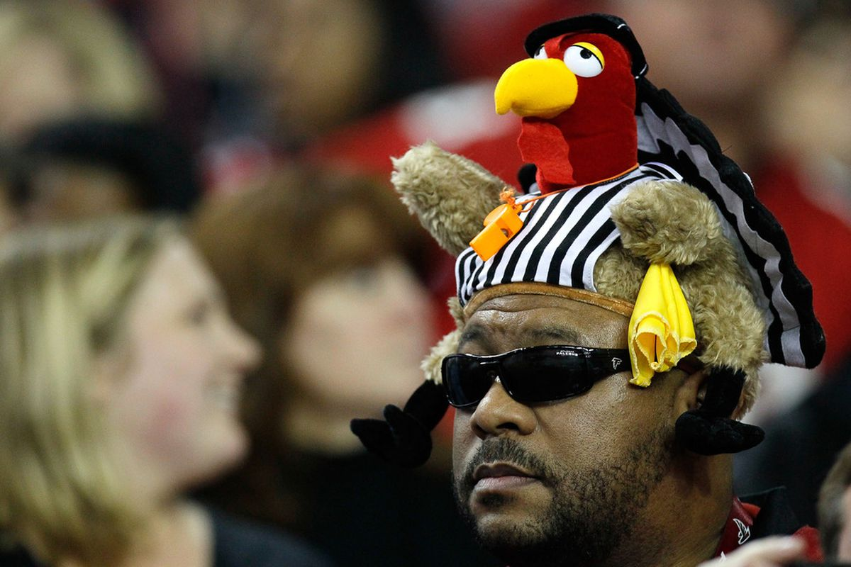 ATLANTA, GA - NOVEMBER 20:  An Atlanta Falcons fan wears a turkey hat in a referee jersey during the game against the Tennessee Titans at Georgia Dome on November 20, 2011 in Atlanta, Georgia.  (Photo by Kevin C. Cox/Getty Images)