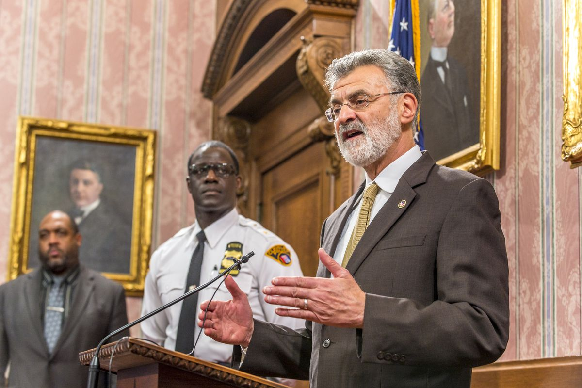 Cleveland's mayor (right) and police chief (center) at a press conference Monday.