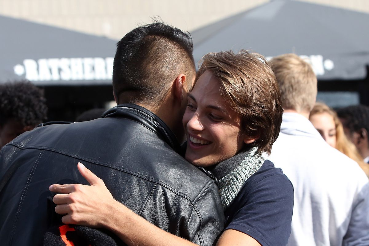 """A German citizen hugging a refugee at a """"welcome fest"""" in Hamburg, Germany, in 2015."""