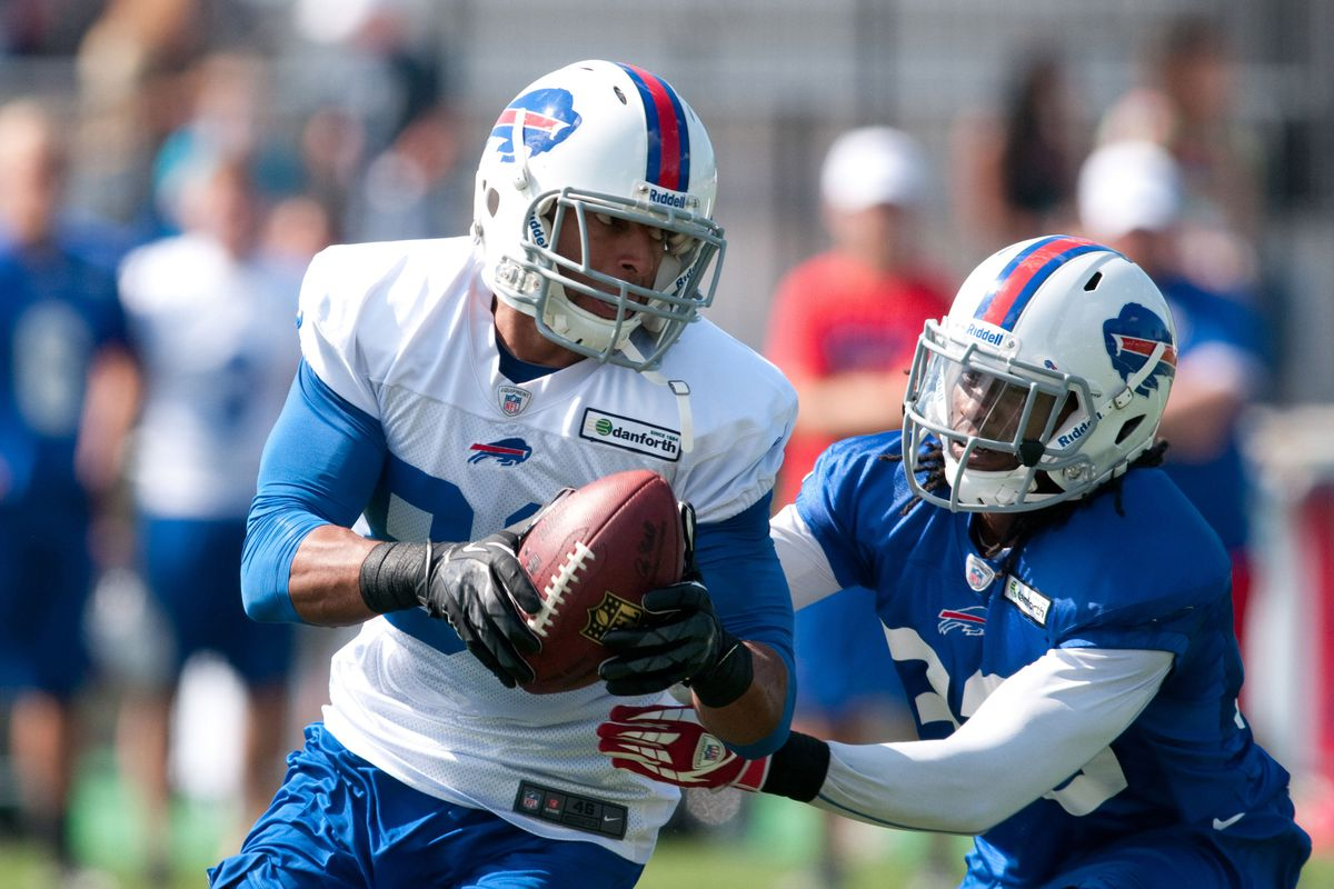 July 27, 2012; Pittsford, NY, USA; Buffalo Bills wide receiver Ruvell Martin (82) makes a catch in front of cornerback Ron Brooks (33) during training camp practice at St. John Fisher College.   Mandatory Credit: Mark Konezny-US PRESSWIRE