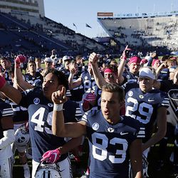 Brigham Young Cougars celebrate after defeating the San Jose State Spartans in NCAA football in Provo on Saturday, Oct. 28, 2017.